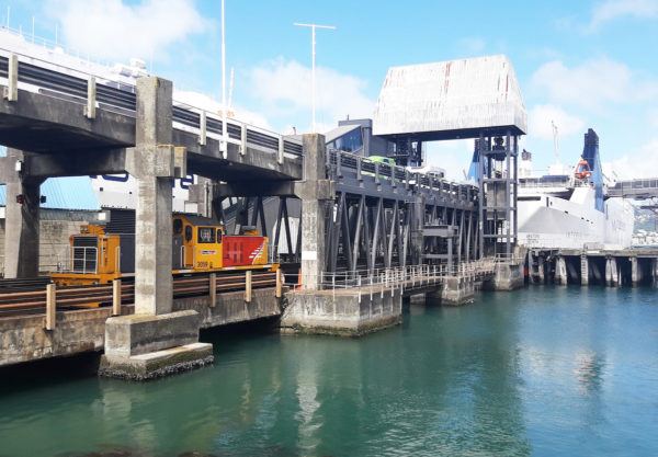 Loading up the ferry with railroad boxcars in Wellington port.