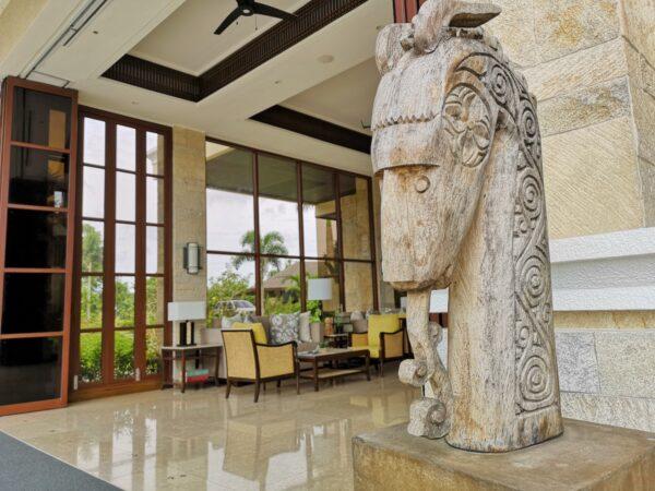 rhdA wooden ornament at the resort lobby entrance