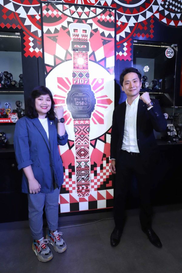 """""""Design the National G-Shock"""" contest winner Dylan Dylanco poses for a photo with International Sales for Timepiece Overseas Marketing and Sales Division Casio Computer Co. LTD sales manager Mr. Masaki Obu, while wearing her winning design."""