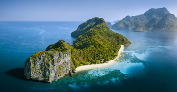 Drone Aerial Panorama image of Helicopter Island in the Bacuit Bay in El Nido, Palawan photo via Depositphotos