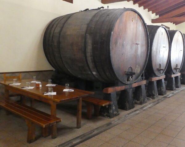 Huge barrels of cider line the walls