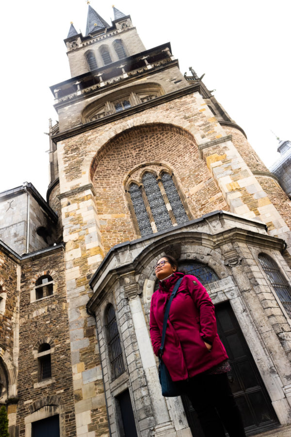 The author standing in front of the main entrance of the Aachen Cathedral.