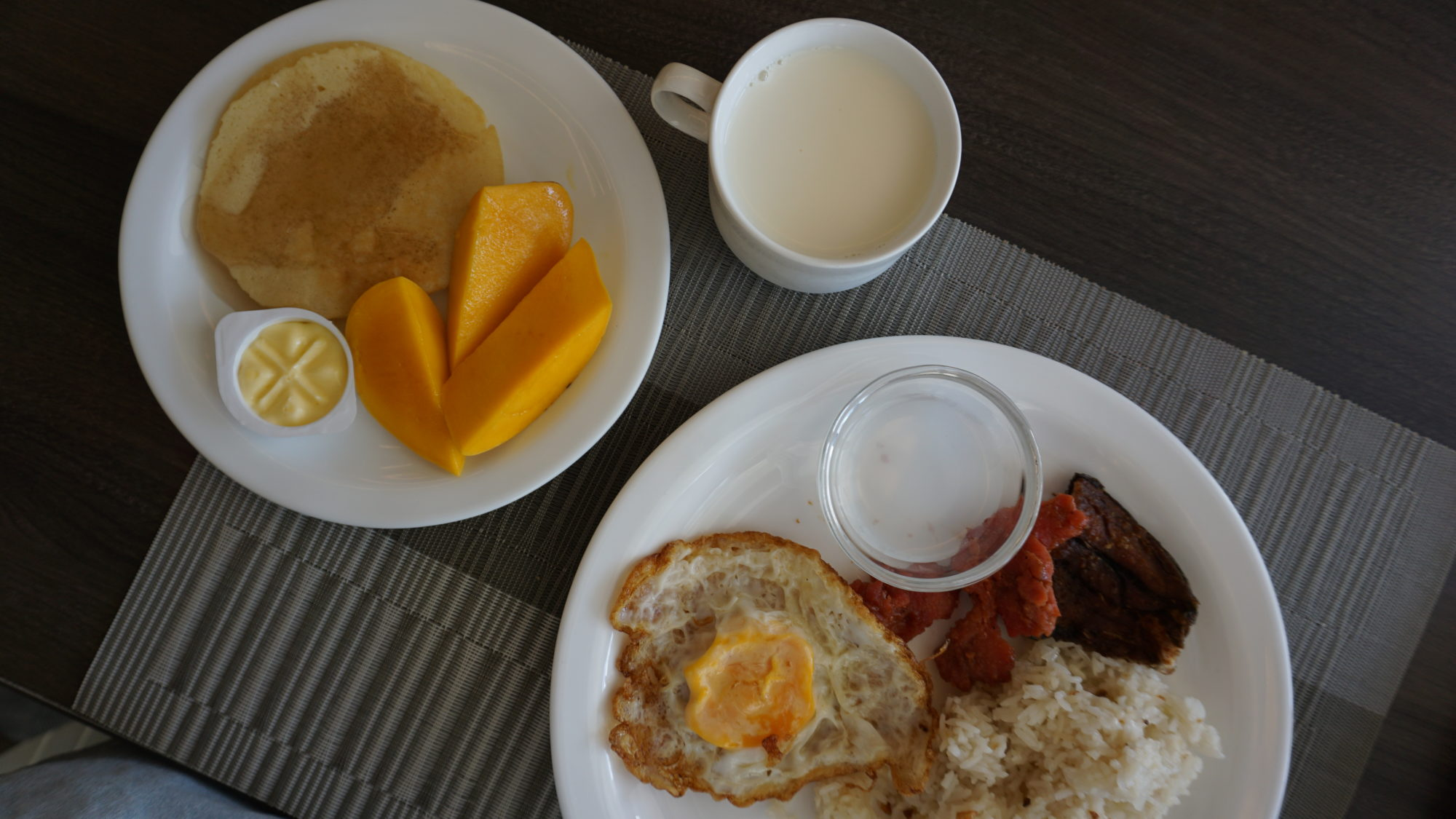 A Filipino breakfast and pancakes served with a side of sweet Guimaras mangoes