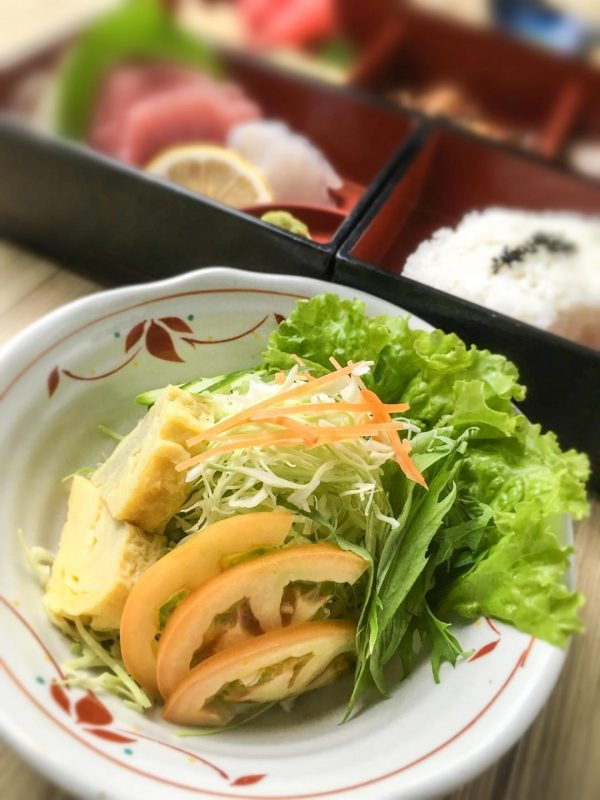 The mouthwatering fresh green salad is a must-try!
