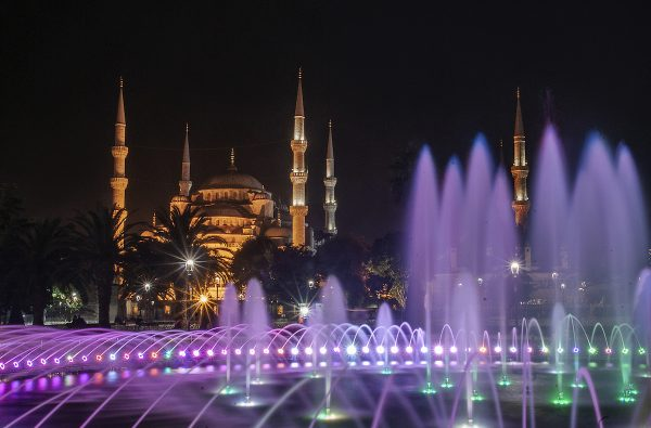 Beautifully-lit Sultanahmet Park's large fountain with the Blue Mosque in the distance.