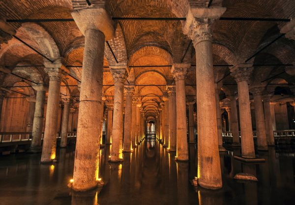 Stone columns and brick-clad arches support the Basilica Cistern's subterranean roof below the city. There still is water with fishes swimming on the floor.