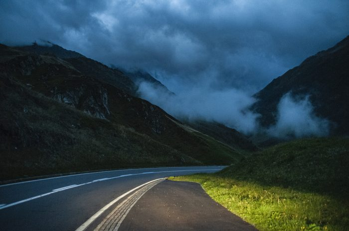 Darkness falls and fog rolls in at the top of the mountain where the zigzag road seems endless.