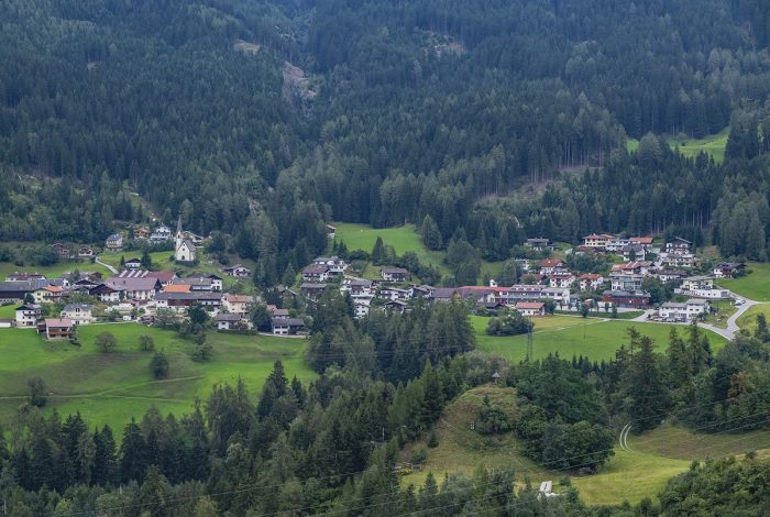 One of the postcard-pretty Swiss villages surrounded by an endless forest of trees