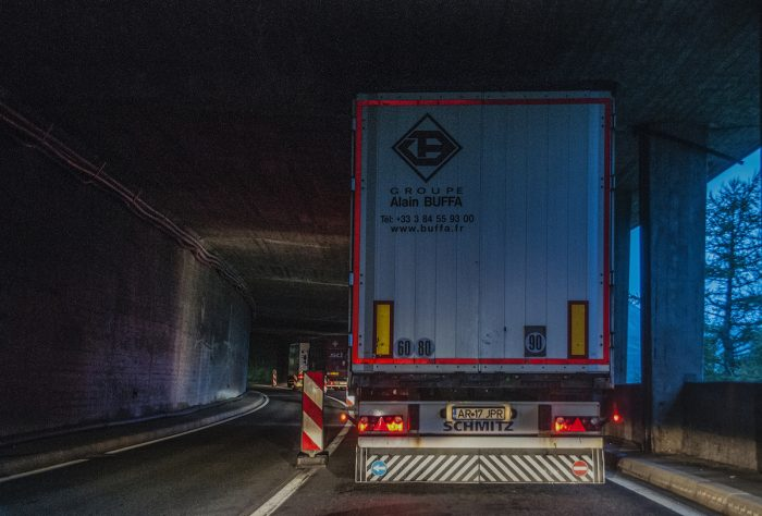 Queueing at one of the numerous Swiss tunnels where most of the traffic are 14-wheelers.