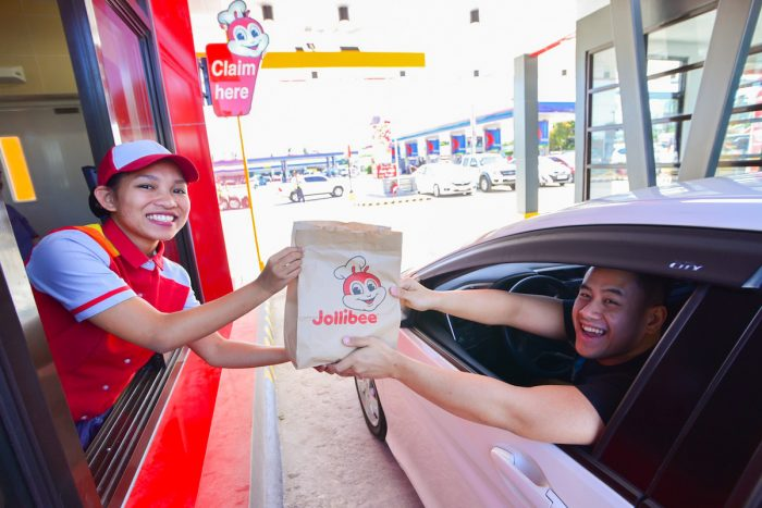 Another satisfied customer joyfully passing through the country's 1st Dual Lane Drive Thru.