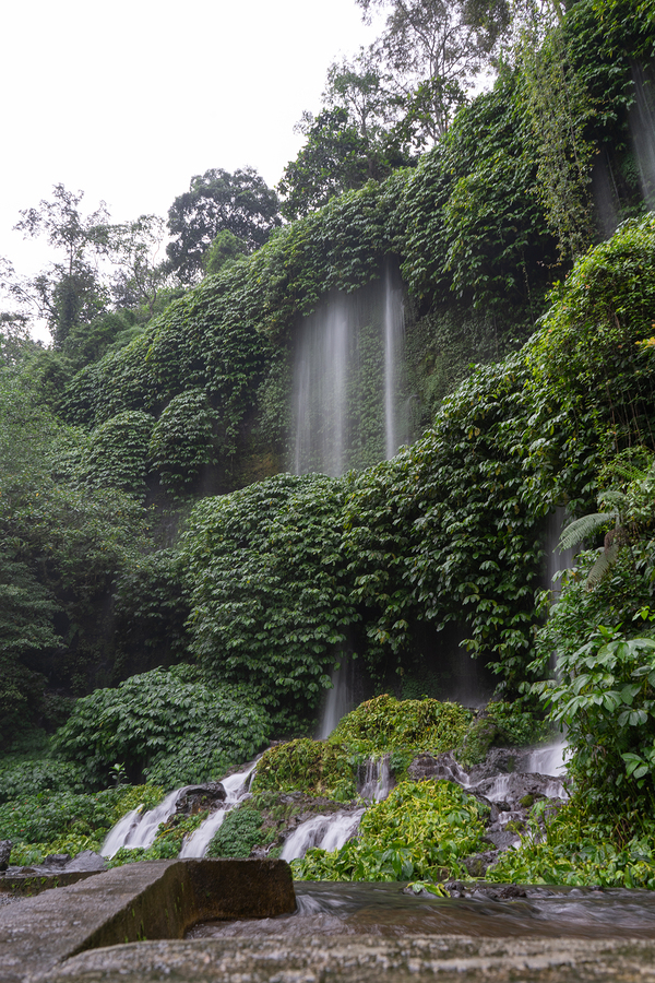 Enjoy the amazing scenery of Benang Kelambu waterfall in the tropical forest in Lombok, Indonesia with fresh and clean water