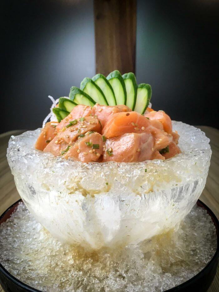 Salmon Sashimi Salad- Marinated Salmon in Special Aokakesu Dressing in a Plate of Ice