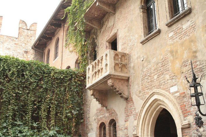 Juliet's purported balcony, in Verona. Beneath it, on the walls, there are love letters.