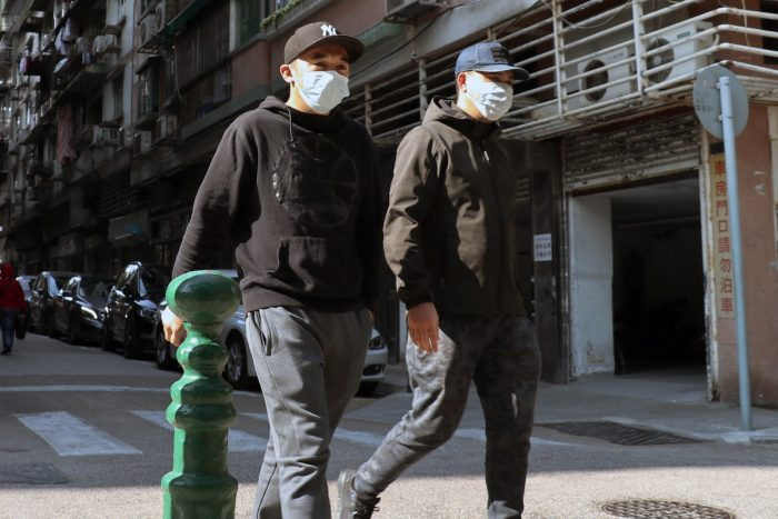 People walk on the street in Macau wearing face masks to protect them to be infected with coronavirus photo by @macauphotoagency via Unsplash