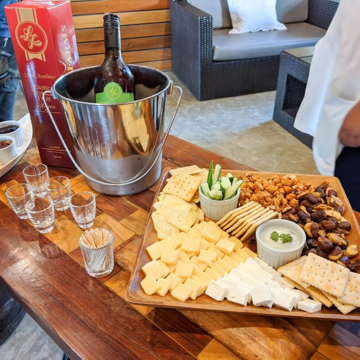 Tropical fruit wines paired with cheese, crackers, and nuts