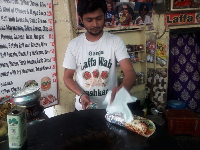 A cook prepares a falafel