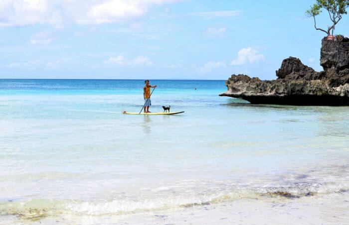Paddleboarding in Boracay by Laurentiu Morariu via Unsplash
