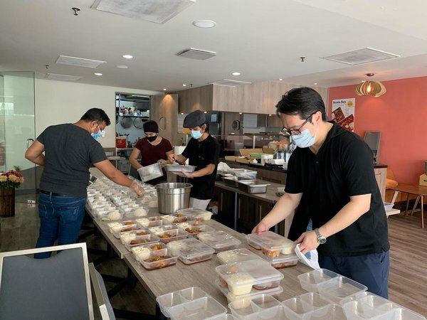 The Terrace Cafe's kitchen crew preparing affordable and finger-lickin' meals for customers amidst the MCO