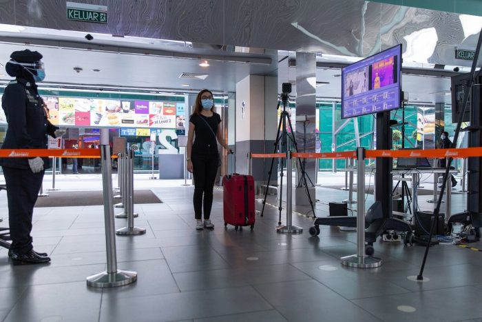A guest going through body temperature screening check at Kuala Lumpur International Airport (klia2) in Kuala Lumpur.
