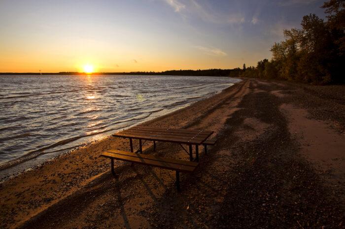 Sunrise on Lake Winnipeg Manitoba Canada photo via Depositphotos