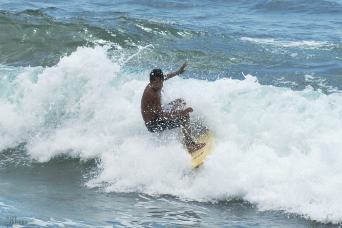 Surfing in San Pancho by JosEnrique via Flickr CC