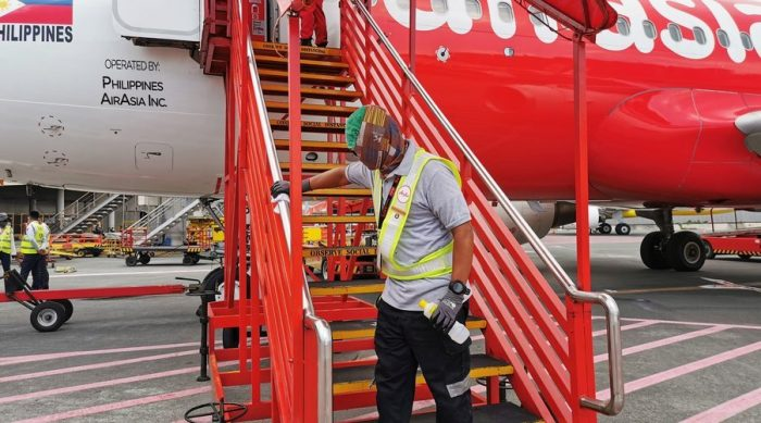 AirAsia Ground Crew disinfecting surfaces before and after each flight.