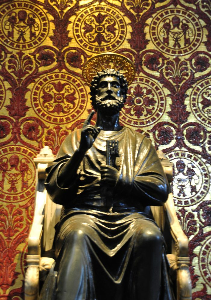 Bronze statue of St. Peter holding the keys with one hand and blessing the visitors with the other hand.