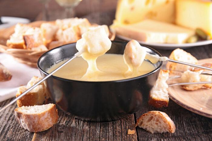 Tasty cheese fondue photo via Depositphotos