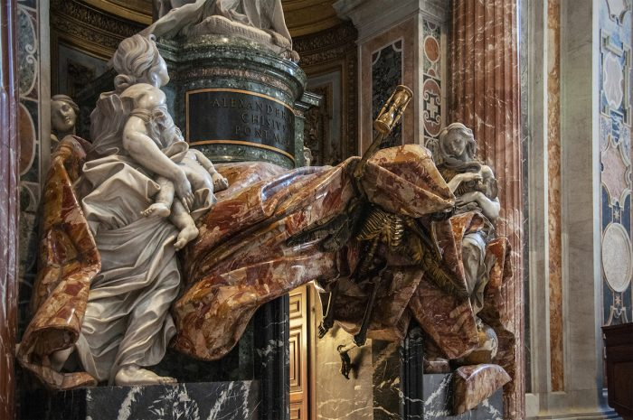 The funeral monument of Pope Alexander VII by Bernini. Note the skeleton underneath the fabrics holding an hourglass telling you that your time has come.