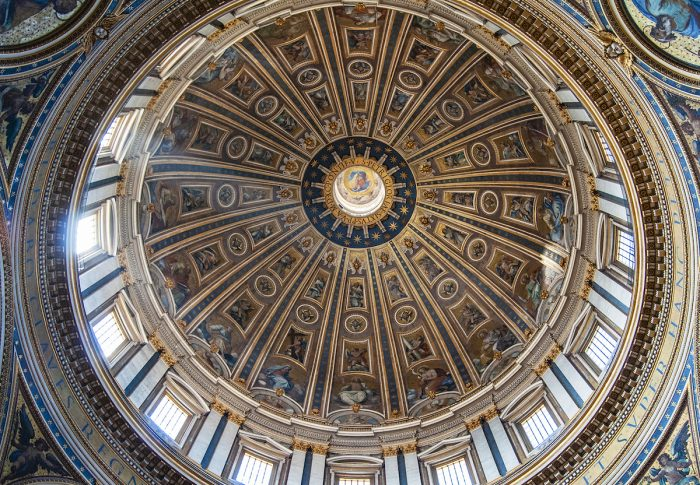 """The inside of the dome with gold tiles and riveting artwork. There is a Latin saying that means """"You are Peter and upon this rock, I will build my church"""". Each letter is almost 3 meters tall!"""
