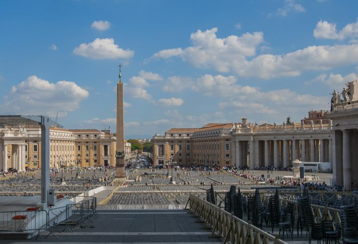 Home.fit The-view-of-Piazza-San-Pietro-with-the-famous-Bernini-columns-on-the-right-and-chairs-being-laid-out-for-a-special-Mass.-700x477 Europe Visita Iglesia #7: St. Peter's Basilica in Rome, Italy