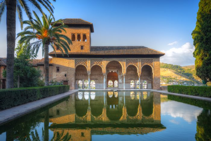 Alhambra patio with pool, Granada in Spain photo via Depositphotos.com