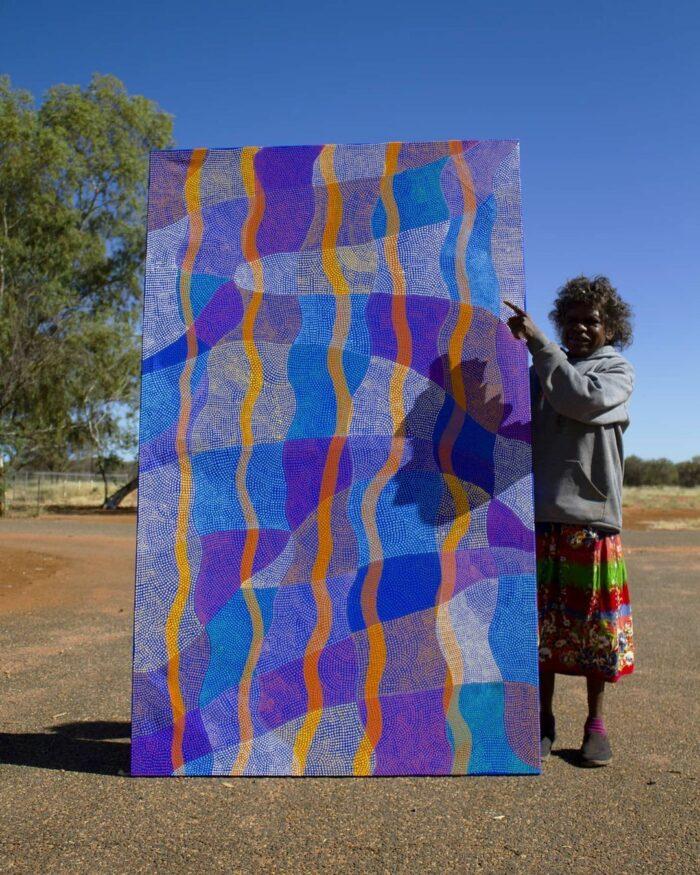 Artist Ann Lane from @ikuntjiartists photo via Visit Central Australia Page