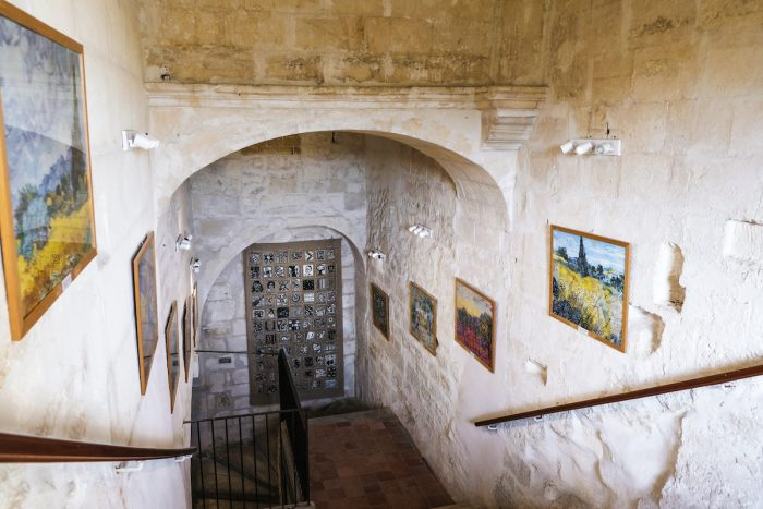 Pictures on the walls of the monastery at the Van Gogh Museum in the psychiatric center at Monastery Saint Paul de Mausole. photo via Depositphotos.com
