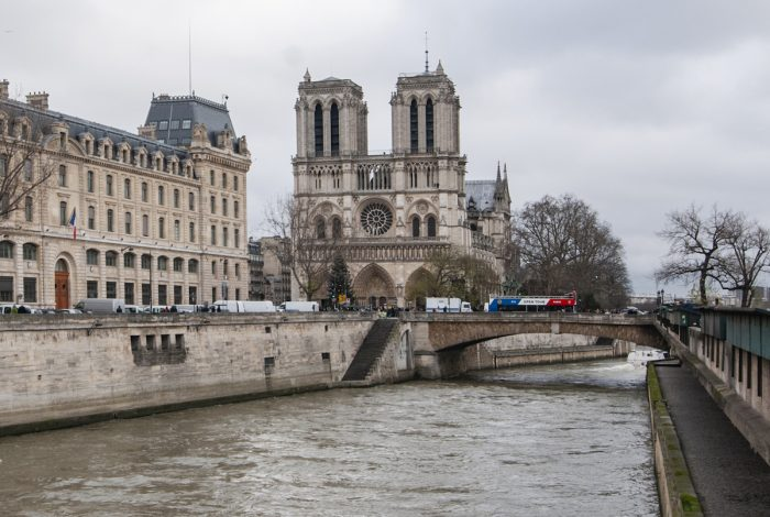 The Seine runs past the Cathedral that's built on an island which splits the river into two branches.