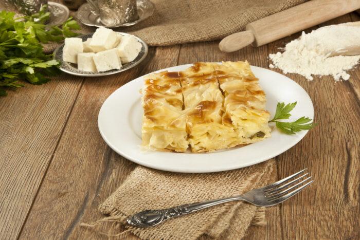 Turkish style meat and cheese stuffed filo dough borek photo via Depositphotos