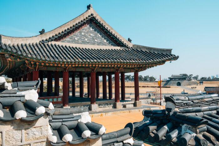 Hwaseong Fortress Dongjangdae Yeonmudae, Korean traditional architecture in Suwon, Korea photo via DepositPhotos.com