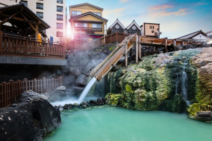 Yubatake Hotspring at Kusatsu Onsen in Gunma, Japan via Depositphotos