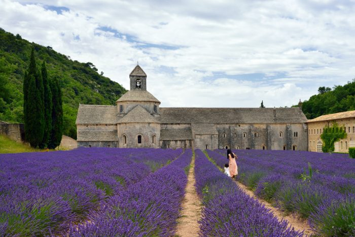 Llavender field at avening. An ancient monastery Abbey of Senanque in background. photo via Depositphotos.com