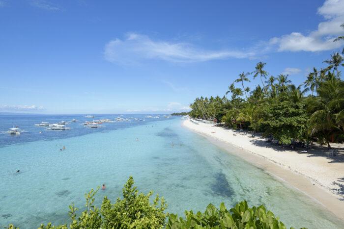 Alona Beach in Panglao Island photo via DepositPhotos