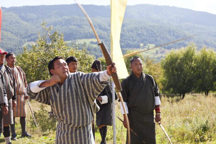 Archery, Bumthang Valley, Bhutan photo via Depositphotos