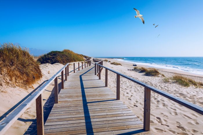 Costa Nova Beach in Aveiro Portugal photo via Depositphotos