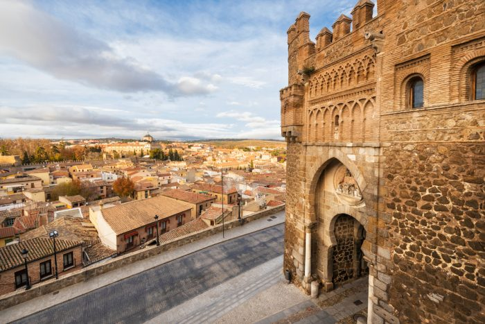 Gate of the sun, historic entrance to the medieval city of Toledo photo via DepositPhotos