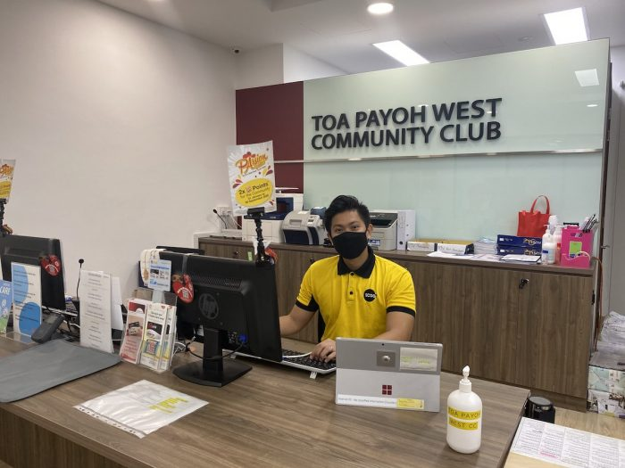 With many flights cancelled due to the COVID-19 pandemic, Joshua Suarez, a cabin crew at Scoot, has been redeployed to work at the community centre, where he helps with mask distribution and financial aid applications for the residents.