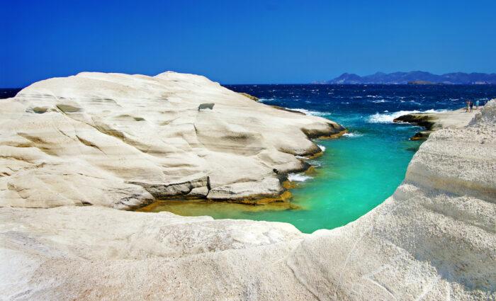Sarakiniko beach in beautiful island of Milos, Greece photo via Depositphotos