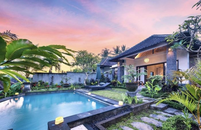The villa is a private pool villa with rice field view