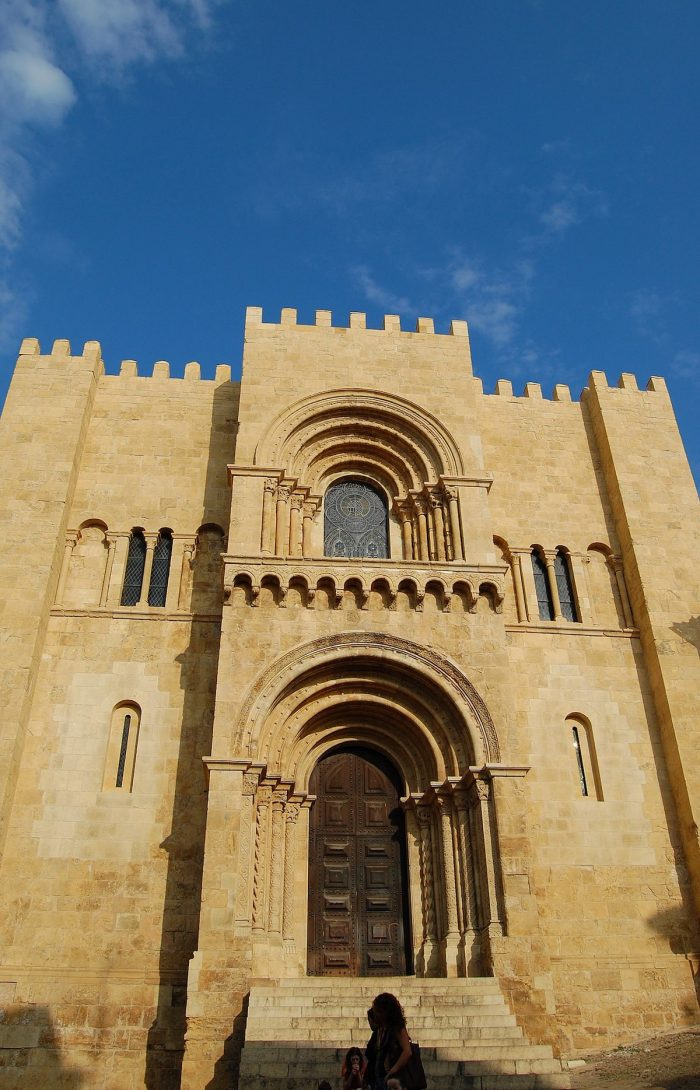 West facade of the Old Cathedral of Coimbra by Aracuano via Wikipedia CC