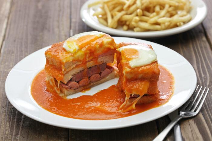 Francesinha - Portuguese sandwich from Porto photo via Depositphotos