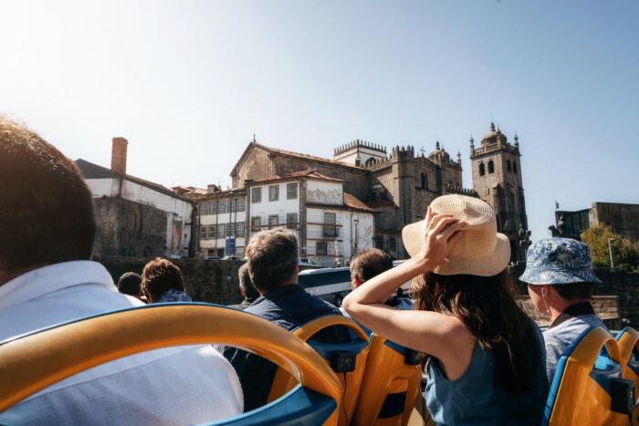 Porto Hop on hop off Tourist Bus photo via Depositphotos