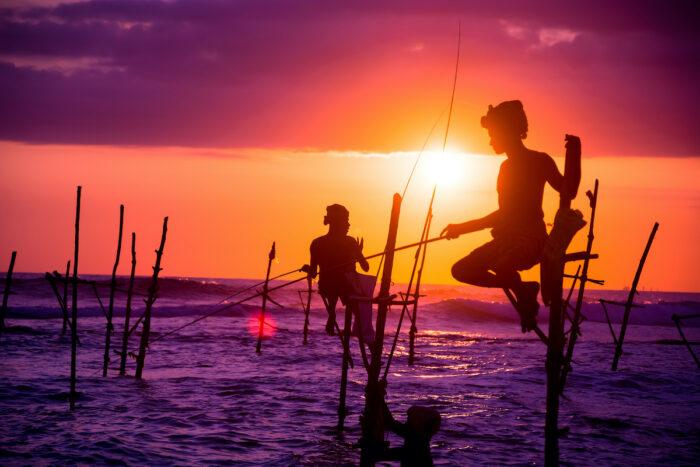 Sri lankan traditional stilt fisherman via Depositphotos